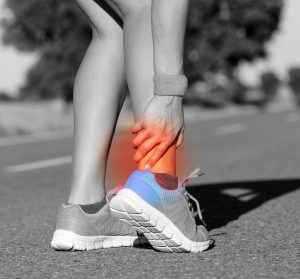 A runner on a road suffering Achilles tendon pain