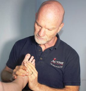 Tim Veysey-Smith examining a patient's foot