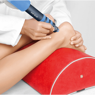 Patient receiving Shockwave Therapy treatment for a tendon injury