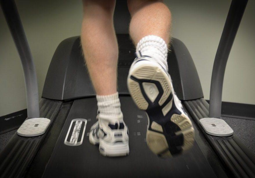 Sports podiatrist using a treadmill for gait analysis